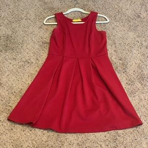 Pleated red tank dress.